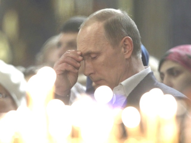 putin-praying-AP