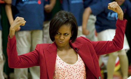 First lady Michelle Obama shows off her muscles